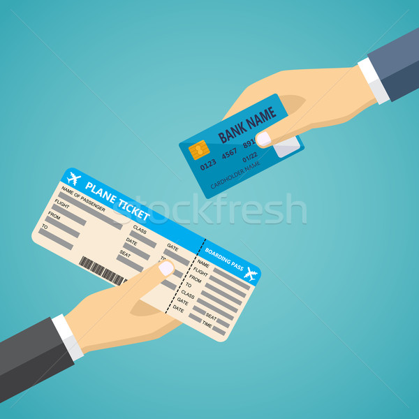 Hand with credit card and hand with boarding pass. Stock photo © Neokryuger