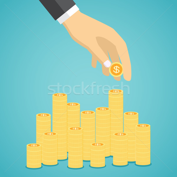Hand put coin to stacks of golden coins Stock photo © Neokryuger