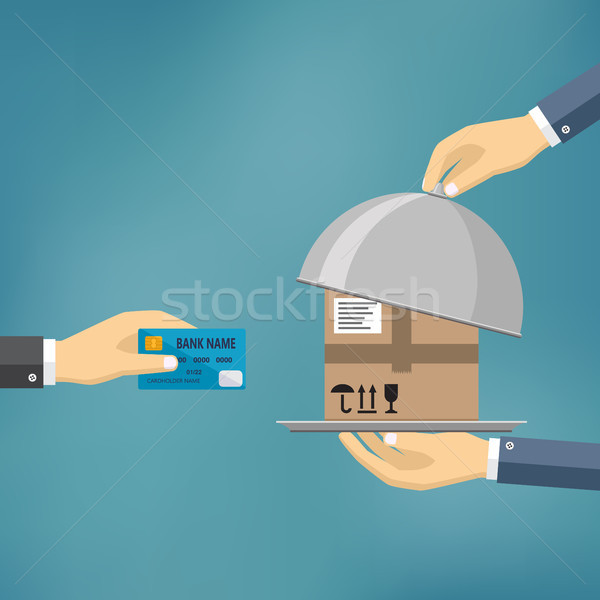 Hand with credit card and hand with parcel. Stock photo © Neokryuger