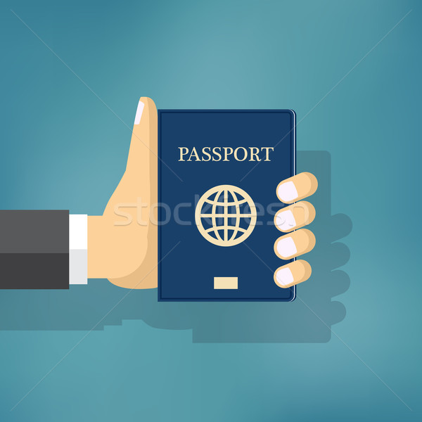 Businessman Hand Hold Passport. Stock photo © Neokryuger