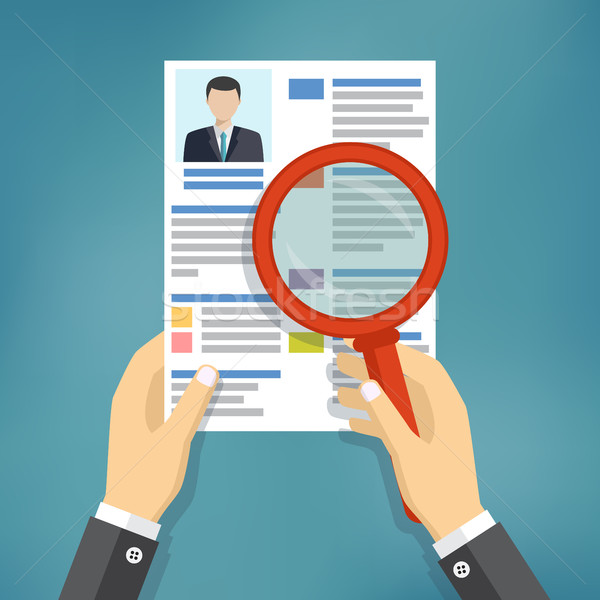 Hands holding a resume and a magnifying glass. Stock photo © Neokryuger
