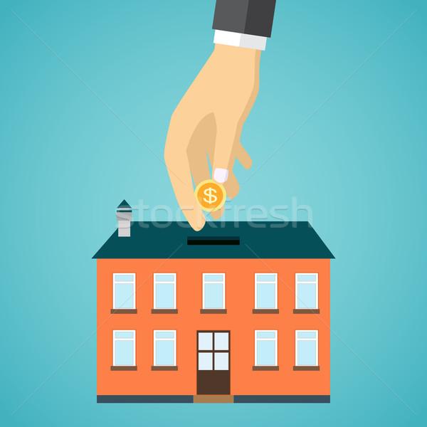 Empresario mano moneda dentro casa vector Foto stock © Neokryuger