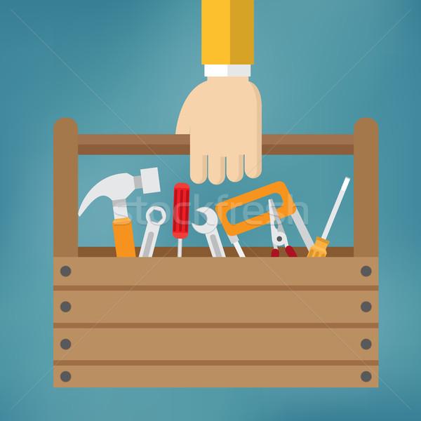 Mão caixa de ferramentas azul construção casa martelo Foto stock © Neokryuger