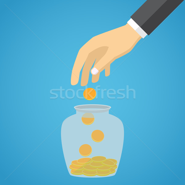 Businessman hand throwing a glass jar gold coin. Stock photo © Neokryuger