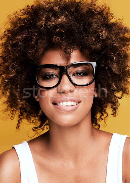 Laughing african american girl with afro. Stock photo © NeonShot