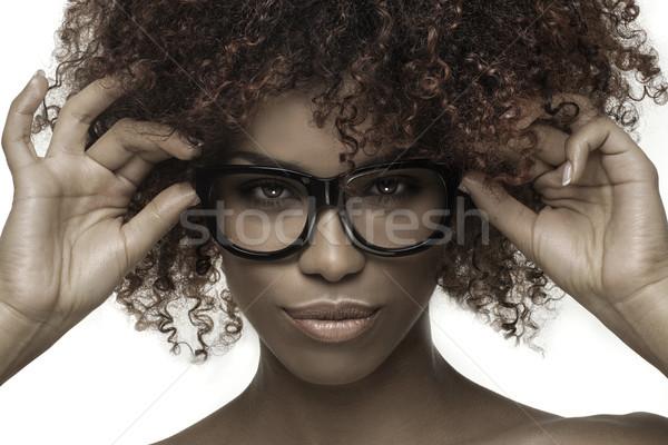 Beautiful girl with afro wearing eyeglasses. Stock photo © NeonShot