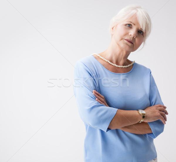 Jól kinéző idős nő pózol stúdió visel Stock fotó © NeonShot