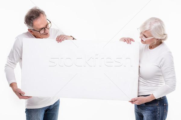Kıdemli güzel çift boş beyaz tahta Stok fotoğraf © NeonShot