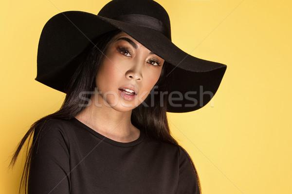 Divatos fiatal ázsiai lány kalap gyönyörű Stock fotó © NeonShot