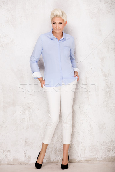 Blonde adult woman posing in studio. Stock photo © NeonShot
