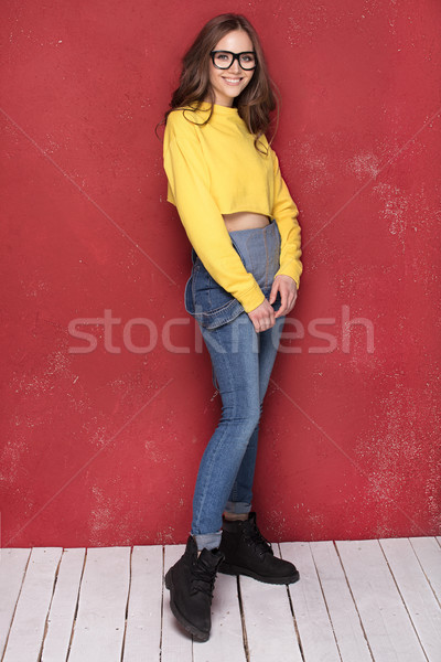 Happy girl smiling, standing on red background. Stock photo © NeonShot