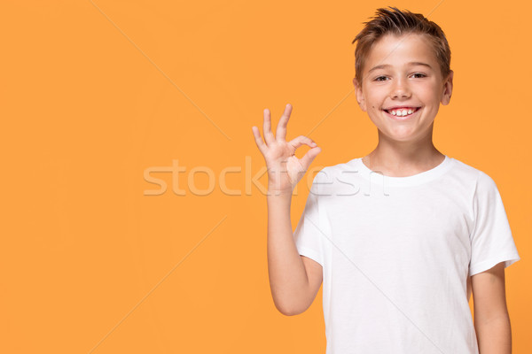 Jungen gefühlvoll wenig Junge orange Studio Stock foto © NeonShot