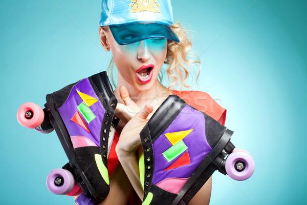 Girl posing with rollers. Stock photo © NeonShot