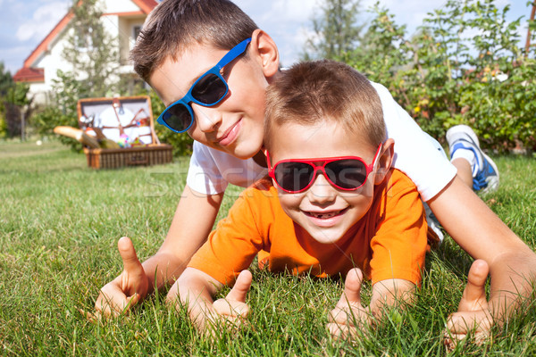 Young brothers playing in the garden. Stock photo © NeonShot