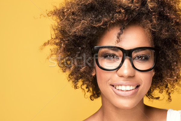 African american girl wearing eyeglasses,smiling. Stock photo © NeonShot