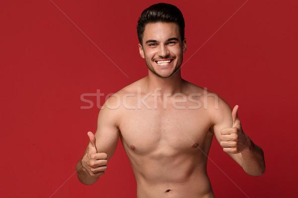 Guapo feliz hombre posando top-less hombre guapo Foto stock © NeonShot