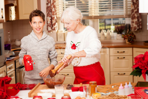 Grandmother with grandchild in kitchen, christmas. Stock photo © NeonShot