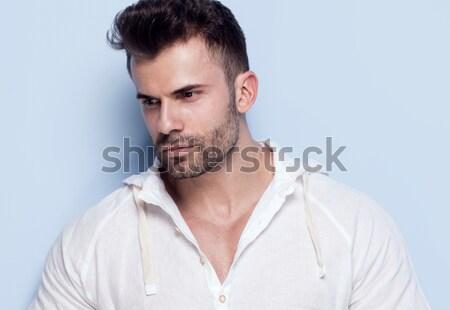 Bel homme posant studio bleu mode modèle Photo stock © NeonShot