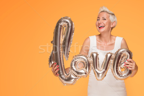 Attractive middle aged woman with love letters. Stock photo © NeonShot