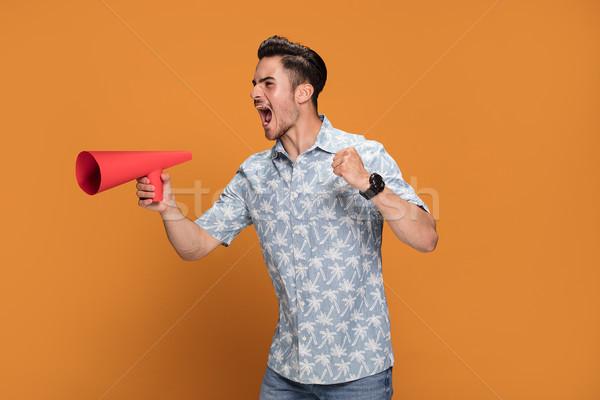Stock fotó: Jóképű · férfi · kiált · megafon · fiatal · izolált · narancs