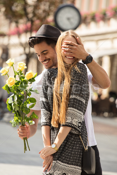 Beautiful couple with flowers dating. Stock photo © NeonShot