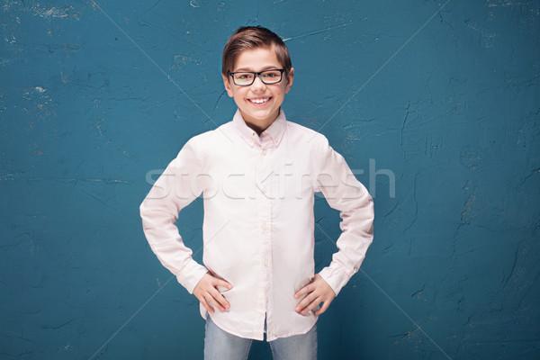 Puce garçon lunettes souriant Kid posant Photo stock © NeonShot