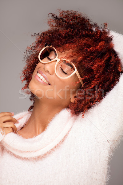 Happy woman with afro hairstyle smiling. Stock photo © NeonShot