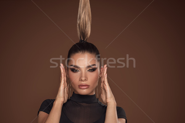 Face of attractive woman in golden makeup. Stock photo © NeonShot