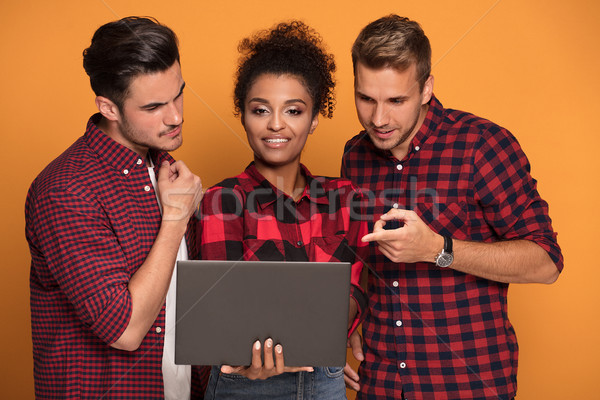 Mixed race friends working together. Stock photo © NeonShot