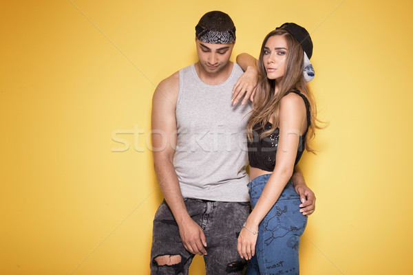 Jeunes modernes couple posant ensemble élégant Photo stock © NeonShot