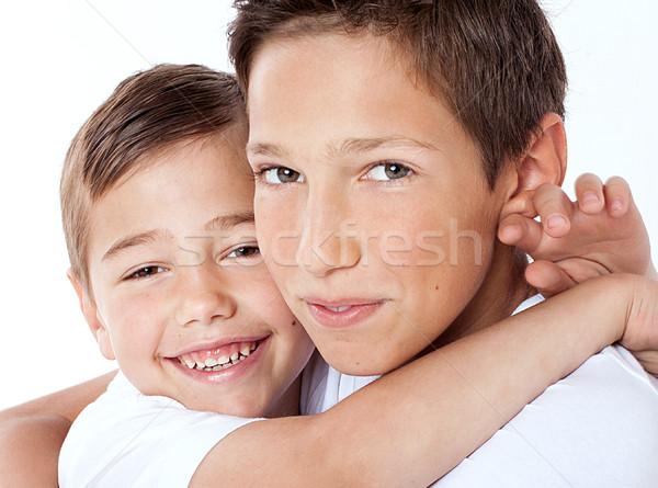 Twee weinig broers poseren home Stockfoto © NeonShot
