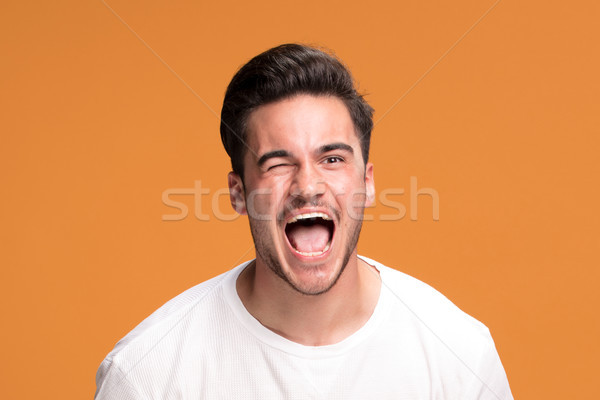 Handsome man blinking eyes. Stock photo © NeonShot