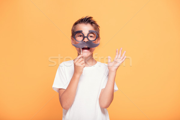 Little child boy with funny moustache. Stock photo © NeonShot