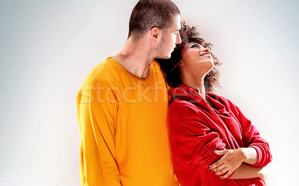Young couple posing in studio. Stock photo © NeonShot