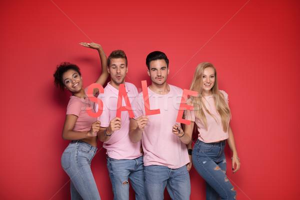 молодые люди красный продажи письма группа молодые Сток-фото © NeonShot