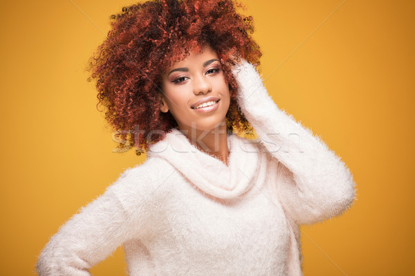 Portrait of beautiful woman with afro hairstyle. Stock photo © NeonShot