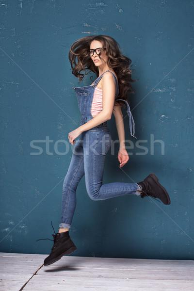 Young natural female model jumping. Stock photo © NeonShot