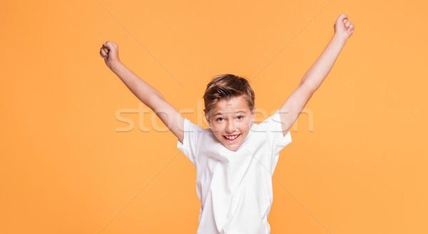 Piccolo ragazzo jumping studio sorridere Foto d'archivio © NeonShot