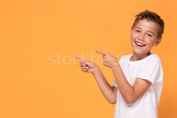 молодые мало мальчика оранжевый студию Сток-фото © NeonShot
