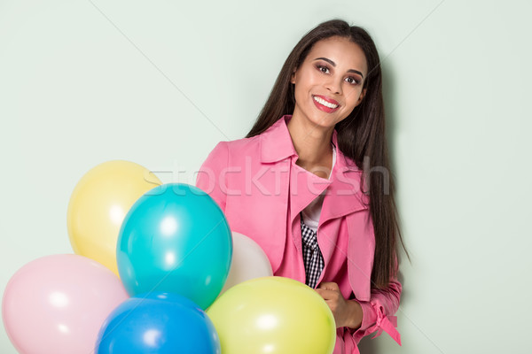 Stock photo: Happy young woman with balloons.