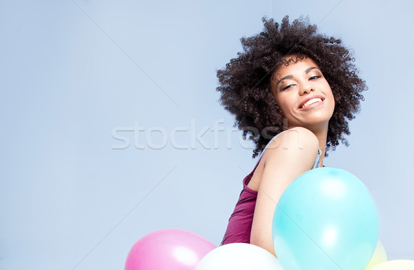Stock photo: Happy african american girl with balloons.