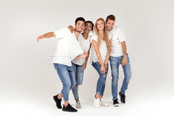 Csoport mosolyog emberek szórakozás együtt fiatal Stock fotó © NeonShot