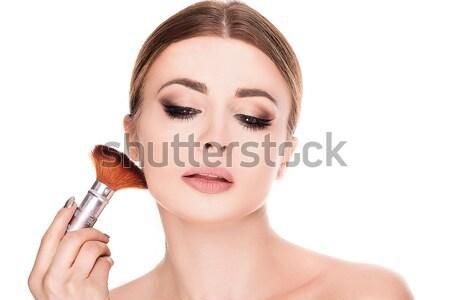 Beauty portrait of woman doing makeup. Stock photo © NeonShot