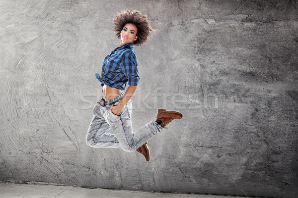 Young girl dancing, jumping. Stock photo © NeonShot