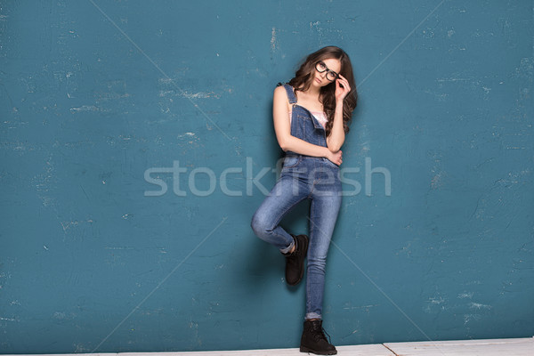 Young natural beauty girl in fashionable clothes posing. Stock photo © NeonShot