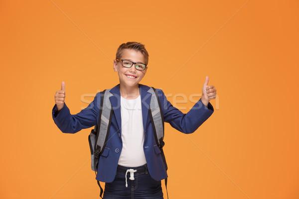 Kicsi iskolás fiú hátizsák mosolyog szemüveg áll Stock fotó © NeonShot