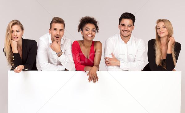 Csoport elegáns emberek üres fehér tábla fiatal Stock fotó © NeonShot