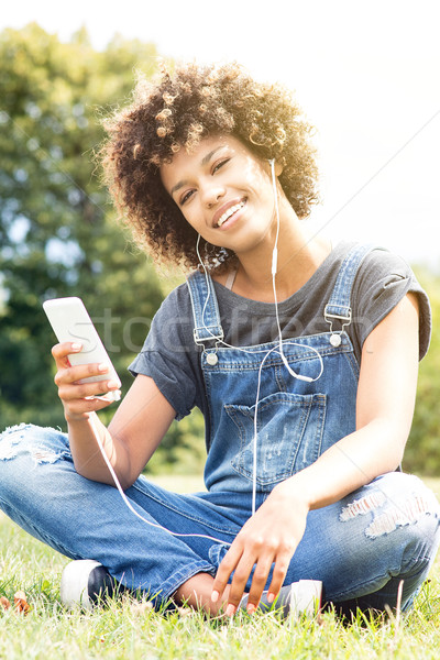 Young african girl relaxing in park. Stock photo © NeonShot