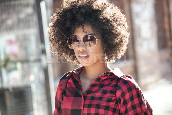 Girl with afro hairstyle. Stock photo © NeonShot