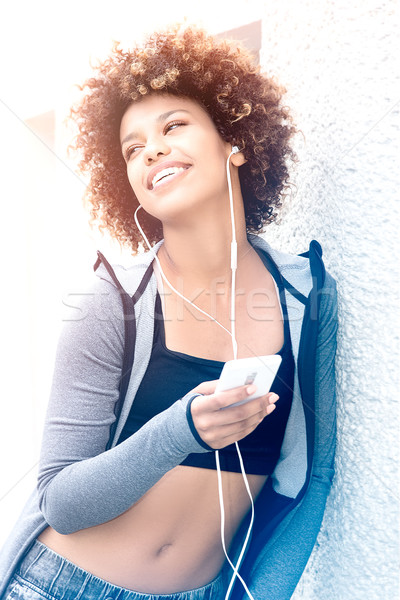 Fit girl with afro posing outdoor. Stock photo © NeonShot